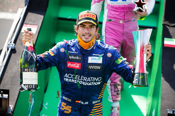 Carlos Sainz, McLaren celebrates on the podium with the chamapgne and the trophy
