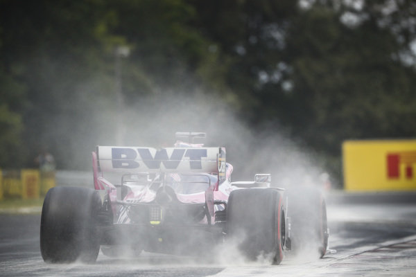 Sergio Perez, Racing Point RP19, kicks up cement dust which was laid down to cover a heavy oil spill in the F2 race prior to the session