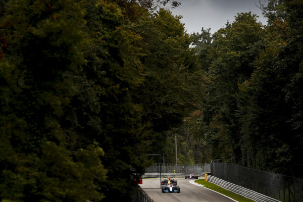 Robert Kubica, Williams FW42, leads Max Verstappen, Red Bull Racing RB15
