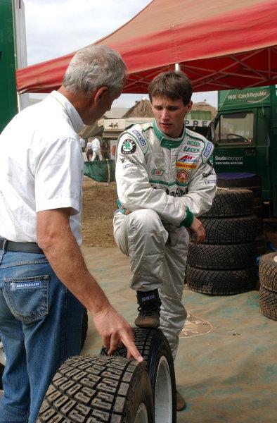 2002 World Rally Championship.Safari Rally, Nairobi Kenya, July 11-14th.Roman Kresta talks tyres with Aime Chatard of Michelin.Photo: Ralph Hardwick/LAT