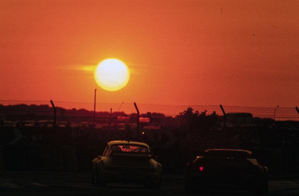Cars at sunset.