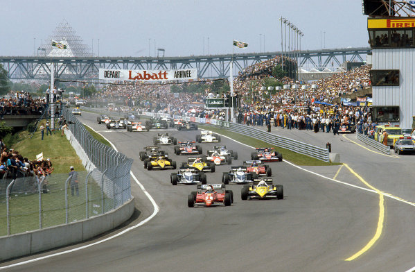 Montreal, Canada.10-12 June 1983.Rene Arnoux (Ferrari 126C2B) leads Alain Prost (Renault RE40), Riccardo Patrese and Nelson Piquet (both Brabham BT52 BMW's) at the start.Ref-83 CAN 07.World Copyright - LAT Photographic