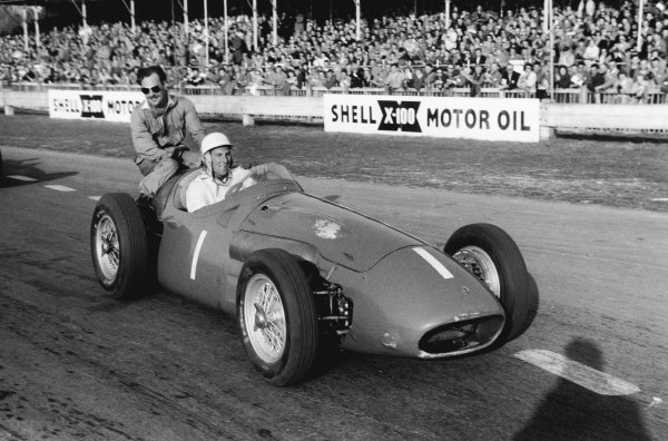 Goodwood, England. 2nd April 1956.Stirling Moss (Maserati 250F), 1st position, gives Archie Scott-Brown a lift back to the pits, portrait.World Copyright: LAT Photographic.Ref: 5963 - 33.