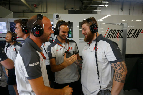Suzuka Circuit, Japan. Saturday 8 October 2016. Haas F1 engineers celebrate a successful qualifying session. World Copyright: Andrew Hone/LAT Photographic ref: Digital Image _ONZ4644