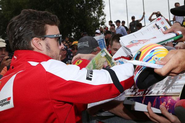Fernando Alonso (ESP) Ferrari signs autographs. Formula One World Championship, Rd1, Australian Grand Prix, Practice, Albert Park, Melbourne, Australia, Friday 15 March 2013.