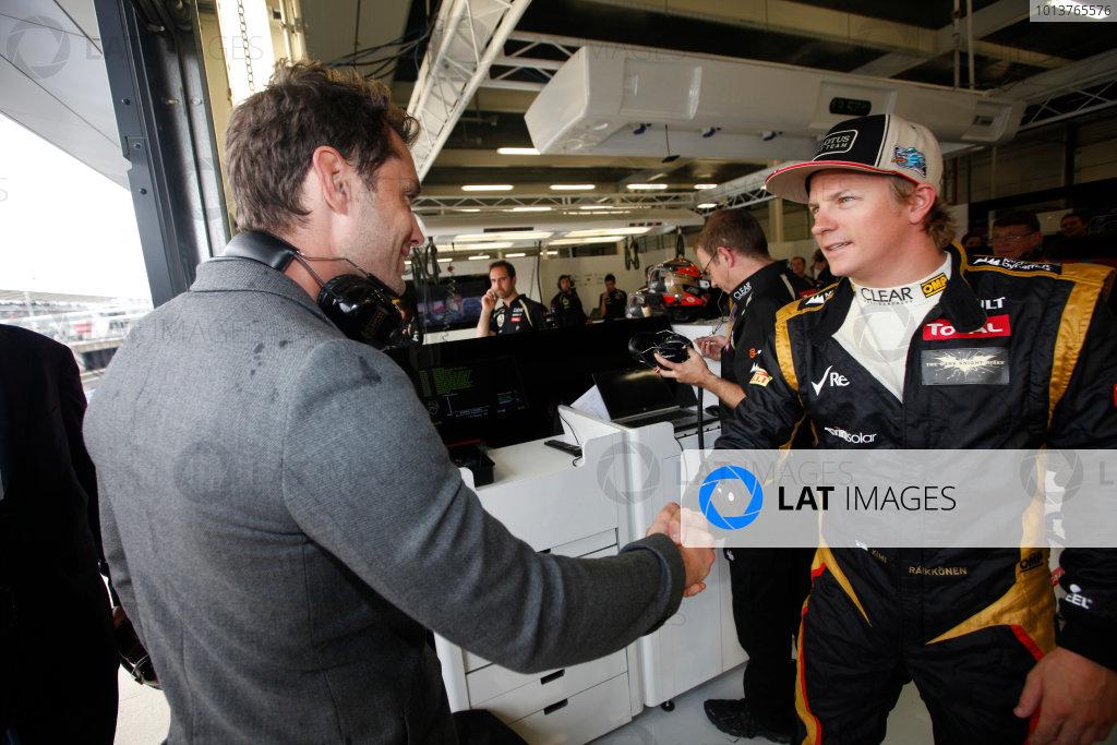 Silverstone, Northamptonshire, England7th July 2012Actor Jude Law visits the Lotus F1 garage and meets Kimi Raikkonen, Lotus GP. World Copyright:Andrew Ferraro/LAT Photographicref: Digital Image AF5D0764