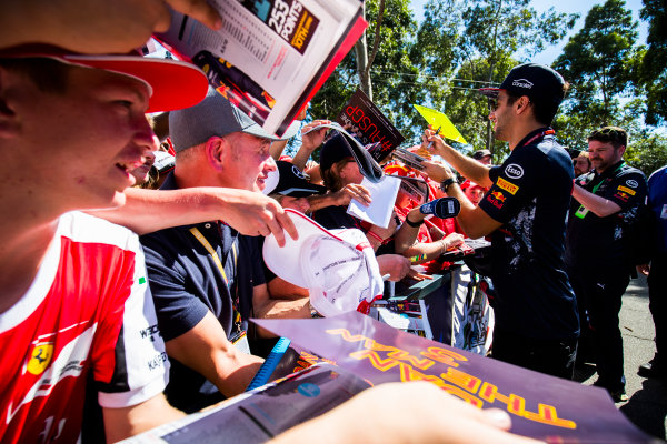 Albert Park, Melbourne, Australia. Saturday 25 March 2017. Daniel Ricciardo, Red Bull Racing, signs autographs for fans. World Copyright: Sam Bloxham/LAT Images Ref: Digital Image _W6I2498
