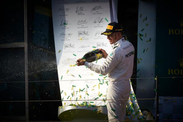 Albert Park, Melbourne, Australia. Sunday 26 March 2017. Lewis Hamilton, Mercedes AMG, 2nd Position, sprays Champagne from the podium. World Copyright: Steve Etherington/LAT Images ref: Digital Image SNE25361