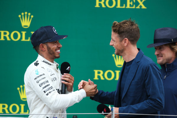 Silverstone, Northamptonshire, UK.  Sunday 16 July 2017. Jenson Button, McLaren, interviews Lewis Hamilton, Mercedes AMG, 1st Position, on the podium. World Copyright: Coates/LAT Images  ref: Digital Image AN7T3470