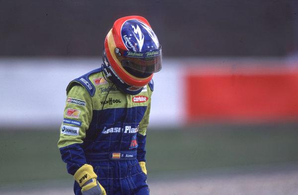 International Formula 3000 Championship Nurburgring, Germany. 19th - 20th May 2000 Fernando Alonso (Astromega) walks back to the pits after crashing with Ricardo Mauricio at the first corner World - Bellanca/LAT Photographic
