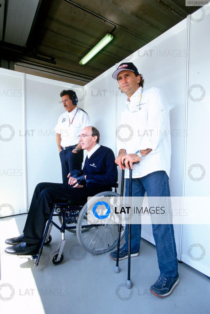 2004 San Marino Grand Prix, Imola, Italy. 23rd - 25th April.Alex Zanardi watches qualifying with Frank Williams and Mario Thyssen.World Copyright: Michael Cooper/LAT PhotographicRef: 35mm Transparency A08