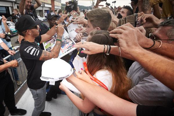 Spa-Francorchamps, Spa, Belgium. Thursday 20 August 2015. Lewis Hamilton, Mercedes AMG, signs autographs for fans. World Copyright: Steve Etherington/LAT Photographic ref: Digital Image SNE15036