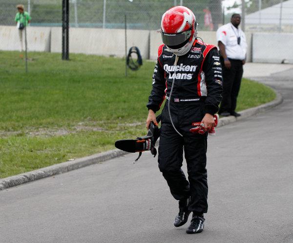 2 June, 2013, Detroit, Michigan, USA AJ Allmendinger walks back to the paddock after hitting a wall on first lap of the race.  Crash ©2013, Todd Davis LAT Photo USA