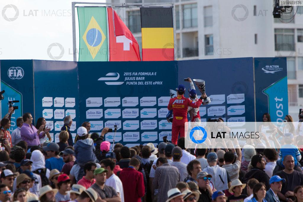 2015/2016 FIA Formula E Championship. Punta del Este ePrix, Punta del Este, Uruguay. Saturday 19 December 2015. Sebastien Buemi (SUI), Renault e.Dams Z.E.15, Lucas Di Grassi (BRA), ABT Audi Sport FE01 and Jerome D'Ambrosio (FRA) Dragon Racing - Venturi VM200-FE-01 on the podium. Photo: Zak Mauger/LAT/Formula E ref: Digital Image _L0U9018