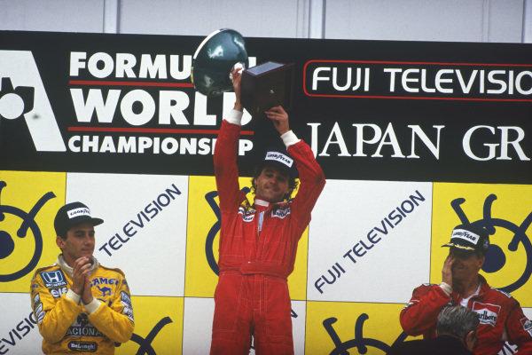 1987 Japanese Grand Prix  Suzuka, Japan. 29th October - 1st November 1987.  Gerhard Berger (Ferrari) 1st position, Ayrton Senna (Team Lotus) 2nd position and Stefan Johansson (McLaren TAG Porsche) 3rd position on the podium.  Ref: 87JAP05. World Copyright: LAT Photographic