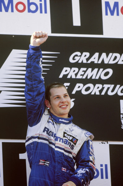 Estoril, Portugal. 20 - 22 September 1996.Jacques Villeneuve (Williams Renault) 1st position, celebrates on the podium, portrait. World Copyright: LAT Photographic.Ref:  96POR02.