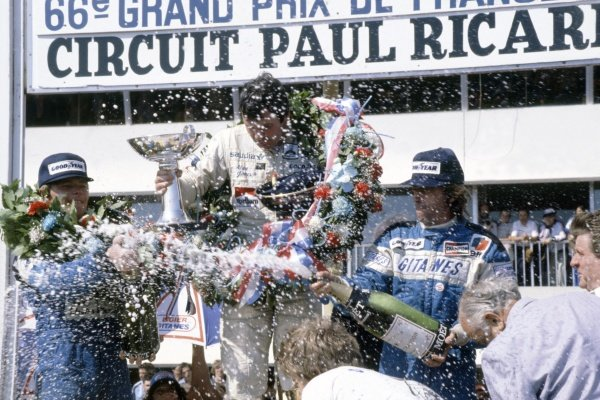 1980 French Grand Prix.Paul Ricard, France. 27-29 June 1980.Alan Jones (Williams FW07B-Ford Cosworth), 1st position, Didier Pironi, 2nd position, and Jacques Laffite (both Ligier JS11/15-Ford Cosworth), 3rd position, on the podium. Champagne.World Copyright: LAT PhotographicRef: 35mm transparency 80FRA05
