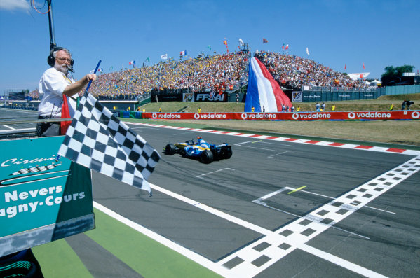 2005 French Grand Prix. Magny-Cours, France. 1st - 3rd July 2005 Fernando Alonso, Renault R25 crosses the line to take victory. Action. World Copyright: Lorenzo Bellanca/LAT Photographic Ref: 35mm Image A25