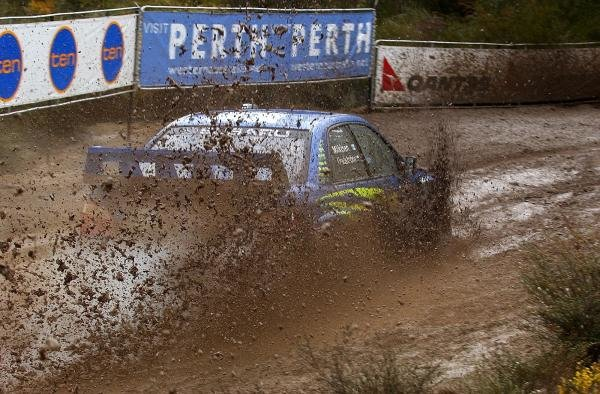 Tommi Makinen (FIN) Subaru Impreza WRC with co-driver Kaj Lindstrom (FIN) heads through a mud bath.