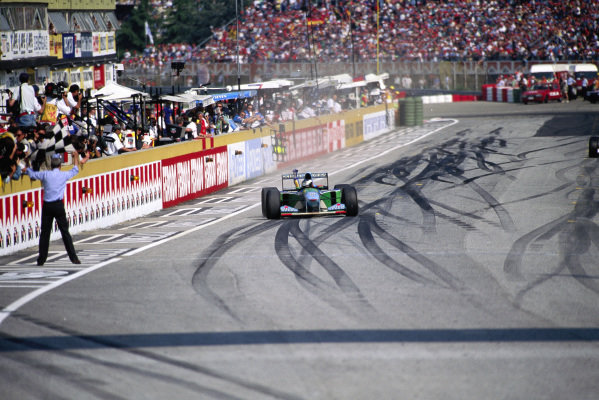 Michael Schumacher, Benetton B194 Ford, celebrates victory.