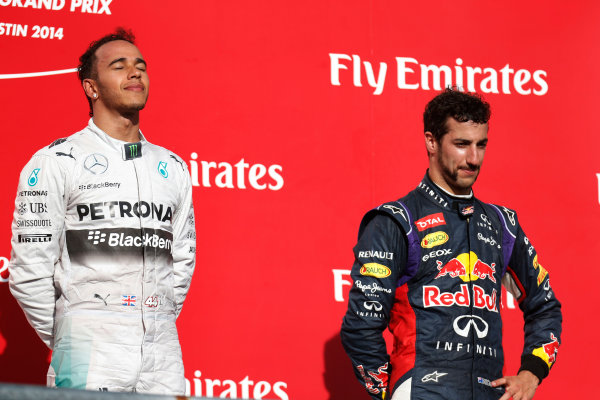 Circuit of the Americas, Austin, Texas, United States of America. Sunday 2 November 2014. Lewis Hamilton, Mercedes AMG, 1st Position, and Daniel Ricciardo, Red Bull Racing, 3rd Position, on  the podium. World Copyright: Alastair Staley/LAT Photographic. ref: Digital Image _R6T4234