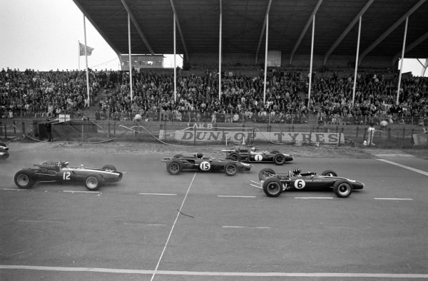 Graham Hill, Lotus 49 Ford leads Jack Brabham, Brabham BT19 Repco and Dan Gurney, Eagle T1G Weslake at the start.