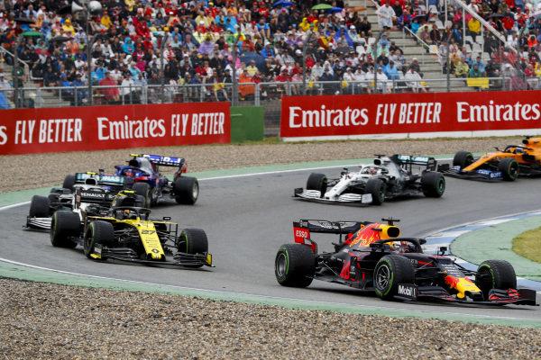 Max Verstappen, Red Bull Racing RB15, leads Nico Hulkenberg, Renault R.S. 19, Valtteri Bottas, Mercedes AMG W10, Alexander Albon, Toro Rosso STR14, Lewis Hamilton, Mercedes AMG F1 W10, and Carlos Sainz Jr., McLaren MCL34