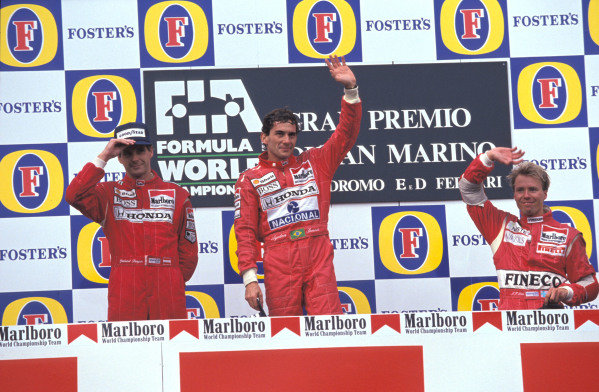 Gerhard Berger, 2nd position, Ayrton Senna, 1st position, and JJ Lehto, 3rd position, on the podium.