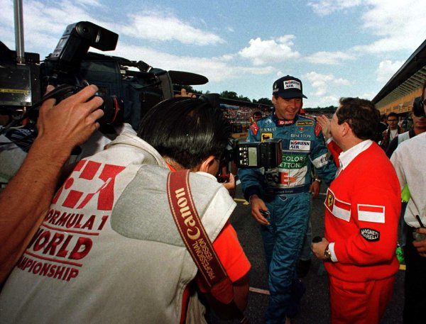 1997 German Grand Prix.Hockenheim, Germany.25-27 July 1997Gerhard Berger (Benetton Renault) is congratulated by Ferrari Team Principal Jean Todt after securing pole position.World Copyright - LAT Photographic
