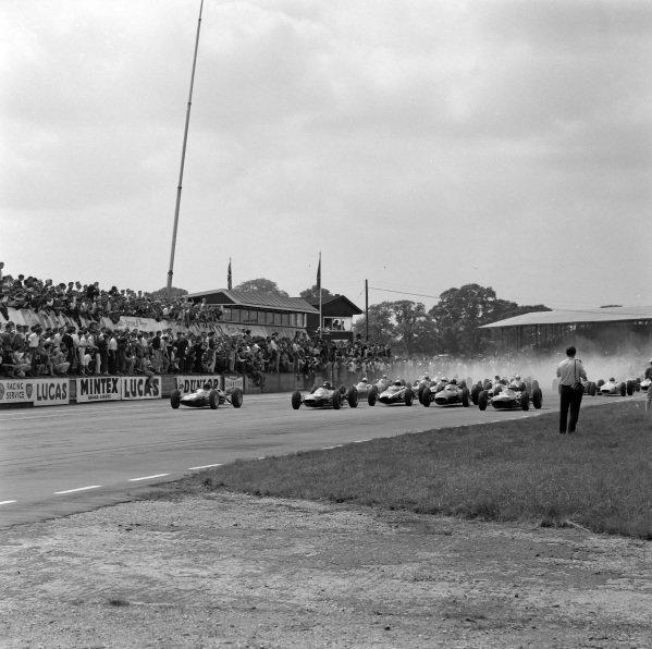 Jim Clark, Lotus 25 Climax, battles with Dan Gurney, Brabham BT7 Climax, at the start.