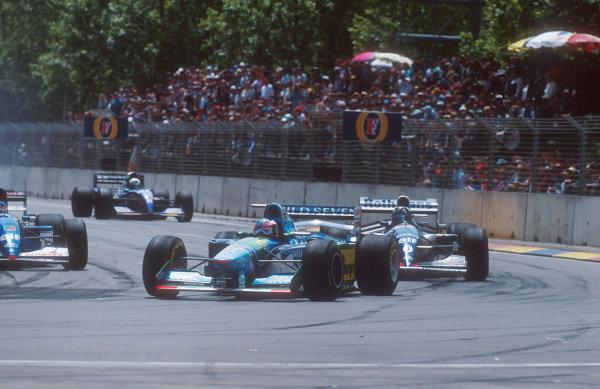 1994 Australian Grand Prix.Adelaide, Australia.11-13 November 1994.Michael Schumacher (Benetton B194 Ford) leads with Damon Hill (Williams FW16B Renault) closing in on him.Ref-94 AUS 05.World Copyright - LAT Photographic