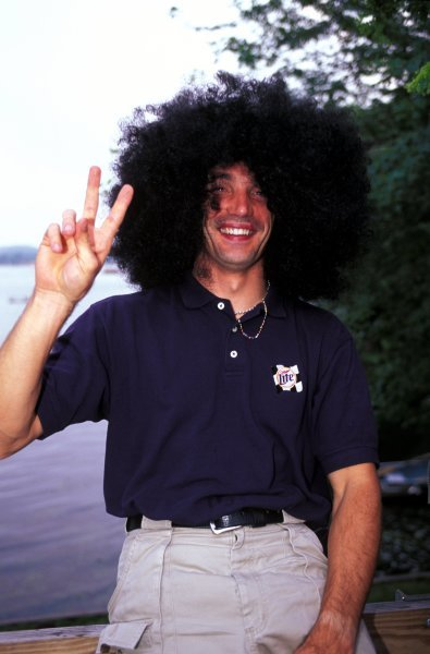 Max Papis (ITA) Team Rahal wears an amazingly trendy wig!Fedex Champ Car World Series, Rd12, Michigan, USA, 25 July 1999.BEST IMAGE