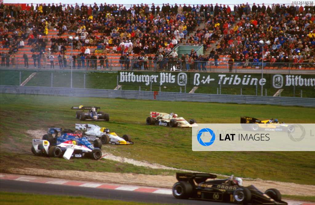 Nurburgring, Germany.5-7 October 1984.On the opening lap Ayrton Senna (Toleman TG184 Hart), Piercarlo Ghinzani (Osella FA1F Alfa Romeo), Marc Surer (Arrows A7 BMW) and Gerhard Berger (ATS D7 BMW) all retired.Ref-84 EUR 02.World Copyright - LAT Photographic