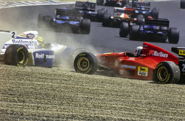 Ayrton Senna, Williams FW16 Renault, and Nicola Larini, Ferrari 412T1, in the gravel trap after coming together at the start of the race.