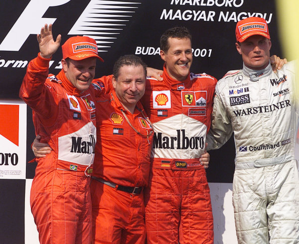 2001 Hungarian Grand PrixHungaroring, Hungary. 19th August 2001.Race winner Michael Schumacher, Ferrari F2001, takes his 4th Formula 1 World Championship, the constructors tiltle for Ferrari and equals Alain Prosts 51 carrer wins. Rubens Barrichello, Ferrari F2001, (2nd) and David Coulthard, West McLaren Mercedes MP4/16 (3rd).World Copyright: Steve Etherington/LAT Photographic.ref: 13 5mb Digital Image Only