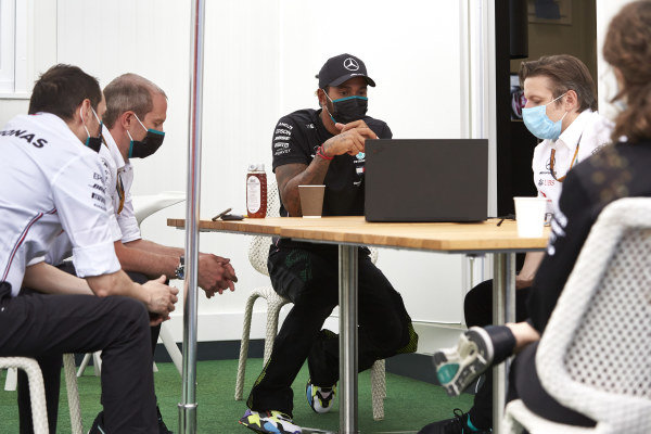 Lewis Hamilton, Mercedes-AMG Petronas F1, with the team in the paddock