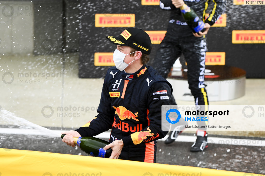 Race winner Liam Lawson (NZL, HITECH GRAND PRIX) celebrates on the podium with the champagne