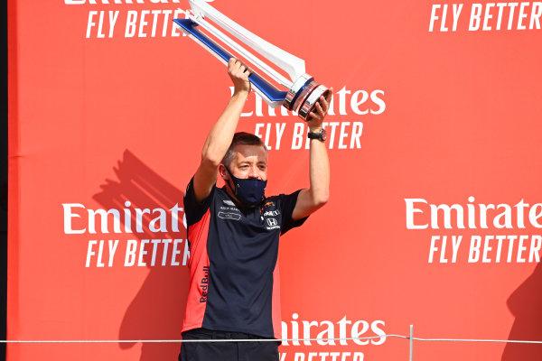 A Red Bull team member celebrates on the podium