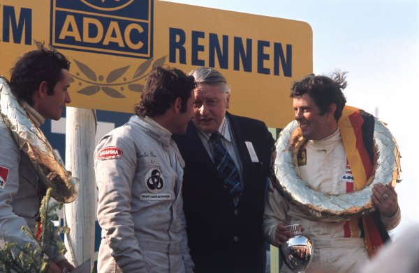 1973 Nurburgring 1000 kms. Nurburgring, Germany. 27th May 1973. Rd 7. L to R: Jacky Ickx (Ferrari 312 PB), 1st position stands next to Carlos Pace (Ferrari 312 PB), 2nd position with Brian Redman (Ferrari 312 PB), 1st position, looking on, podium, portrait. World Copyright: LAT Photographic.