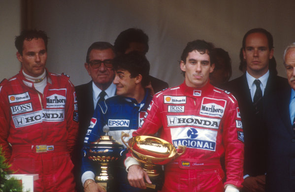 1990 Monaco Grand Prix. Monte Carlo, Monaco. 25-27 May 1990. Ayrton Senna (McLaren Honda) 1st position, Jean Alesi (Tyrrell Ford) 2nd position and Gerhard Berger (McLaren Honda) 3rd position on the podium. Behind stands FIA President Jean-Marie Balestre and HSH Prince Albert. Ref-90 MON 04. World Copyright - LAT Photographic