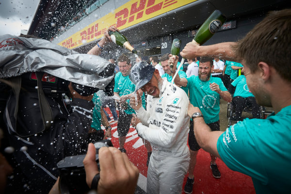 Silverstone, Northamptonshire, UK.  Sunday 16 July 2017.Lewis Hamilton, Mercedes AMG, sprays the champagne with his team after winning the race. World Copyright: Steve Etherington/LAT Images  ref: Digital Image SNE10420