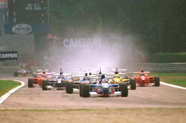 Monza, Italy.5-7 September 1997.Polesitter Jean Alesi (Benetton B197 Renault) leads the field at the start.Ref-97 ITA 01.World Copyright - LAT Photographic