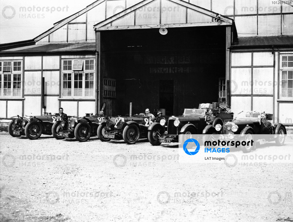 Le Mans, France.17-18 June 1933.The Aston Martin team leave the factory. The Aston Martin Ulster race cars of Auguste Cesar Bertelli/Sammy Davis (number 24), Patrick Driscoll/SC Penn-Hughes (25) and Elsie Wisdom/Mortimer Morris-Goodall (26) are on the left.Ref-Autocar S91/284.World Copyright - LAT Photographic