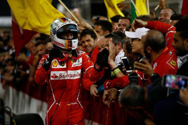 Bahrain International Circuit, Sakhir, Bahrain.  Sunday 16 April 2017. Sebastian Vettel, Ferrari, 1st Position, celebrates in Parc Ferme with his team. World Copyright: Andrew Hone/LAT Images ref: Digital Image _ONY8505