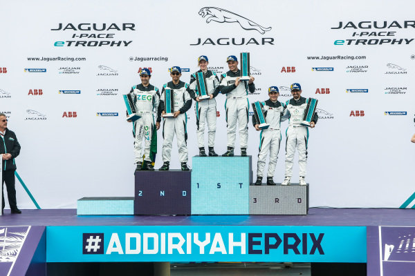The drivers of both PRO and AM classes share the podium
