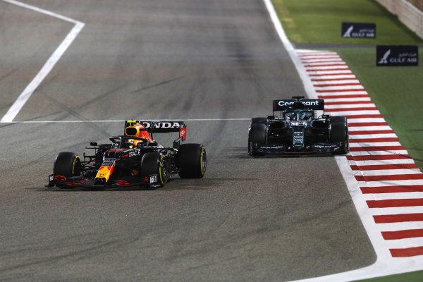 Sergio Perez, Red Bull Racing RB16B, leads Lance Stroll, Aston Martin AMR21