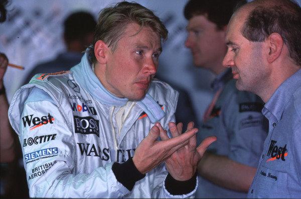 1999 Canadian Grand Prix.Montreal, Quebec, Canada.11-13 June 1999.Mika Hakkinen talks with McLaren Mercedes-Benz Technical Director Adrian Newey.Ref-99 CAN 21.World Copyright - LAT Photographic