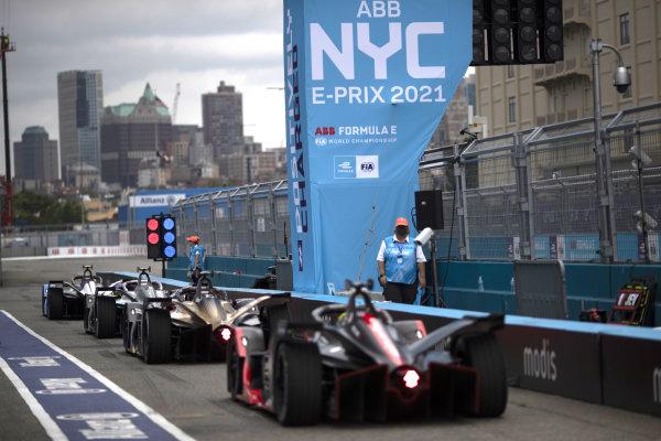 Stoffel Vandoorne (BEL), Mercedes Benz EQ, EQ Silver Arrow 02, and Jean-Eric Vergne (FRA), DS Techeetah, DS E-Tense FE21, wait to leave the pit lane