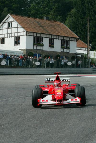 2002 Belgian Grand Prix - PracticeSpa-Francorchamps, Belgium. 30th August 2002.Michael Schumacher (Ferrari F2002) at La Source Hairpin.World Copyright - LAT Photographicref: digital file only