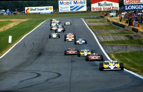 1981 British Grand Prix.Silverstone, England.16-18 July 1981.Alain Prost (Renault RE30) leads the field down Hangar Straight at the start.World Copyright - LAT Photographic